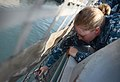 U.S. Navy Electronics Technician 1st Class Rachel Preston secures flight deck nets aboard the littoral combat ship USS Freedom (LCS 1) as the ship gets underway in Singapore May 21, 2013 130521-N-PD773-031.jpg