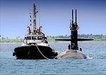 USN Tug escorts USS Dallas at Diego Garcia.jpg