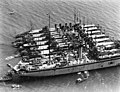 USS Dobbin (AD-3) at anchor with destroyers off Gonaïves, Haiti, in March 1928 (NH 61556).jpg