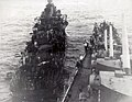 USS Haggard (DD-555) is assisted by USS San Diego (CL-53), after being hit by a kamikaze off Okinawa on 29 April 1945.jpg