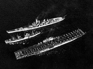 USS Rainier (AE-5) replenishing Antietam (CV-36) and Wisconsin (BB-64) off Korea 1952.jpeg
