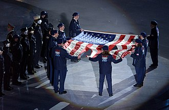 Members of the US Olympic team at the Rice-Eccles Olympic Stadium holding the American flag that flew over the World Trade Center on September 11, 2001 US Navy 020208-N-3995K-002 2002 Olympics - WTC Flag.jpg