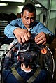 US Navy 031205-N-6213R-014 Mr. Mike Diaz, a contracted civilian technician with Naval Sea Systems Command, checks a respirator testing shroud to assess the proper fit of MCU-2P gas masks.jpg
