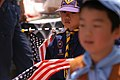 US Navy 040515-N-1194D-010 A young Japanese Cub Scout marches in a parade during the 65th Shimoda Black Ship Festival.jpg