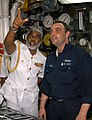 US Navy 050221-N-4702D-060 Machinist Mate 1st Class Michael A. Hohn shows the Commander of the Sri Lanka Navy, Vice Adm. D.W.K. Sandagiri, the different equipment a Sailor must monitor while on watch (cropped).jpg