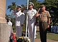 US Navy 050514-N-5411L-023 Royal Australian Navy representative Cmdr. Plath, Commander, Amphibious Group Three, Rear Adm. Christopher Ames and Col. Thomas Greenwood show their respect to those lost in the 1942 Battle of Coral S.jpg
