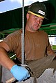 US Navy 050517-N-9712C-001 Utilitiesman Constructionman Chuck Druesdow smears mortar to join concrete blocks while constructing a wall on board Camp Courtney, Okinawa.jpg