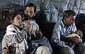US Navy 051021-F-9085B-119 Pakistani men comfort injured children being transported to Islamabad aboard a U.S. Navy MH-53 Sea Dragon helicopter.jpg