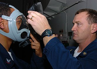 Face shield - Atlantic Ocean (Jan. 27, 2006) - Chief Damage Controlman, John Brooks, removes the face shield from a Sailor's MCU-2/P gas mask after washing it with decontamination solution during a General Quarters Drill aboard the Nimitz class aircraft carrier USS Dwight D. Eisenhower (CVN 69). Eisenhower is underway conducting carrier qualifications.