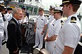 US Navy 060604-N-0696M-240 Secretary of Defense Donald H. Rumsfeld talks with four new lieutenants after presiding over their promotion ceremony.jpg