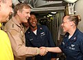 US Navy 061024-N-5928K-021 Commander Fifth Fleet, Vice Adm. Patrick Walsh, greets Mass Communication Specialist 2nd Class Molly Burgess and Machinist's Mate 2nd Class Glendon Austin during a visit to the nuclear-powered aircraf.jpg