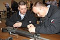 US Navy 070304-N-4034B-011 Aviation Electrician's Mate 2nd Class Adam Puckett and Electronics Technician 2nd Class Christopher, Navy Reservists from Greensboro, N.C., disassemble an M-16 rifle in a weapons familiarization.jpg