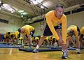 US Navy 070627-N-1328C-035 1st Marine Logistics Group (1st MLG) Command Master Chief (CMDCM) German Fiesco and other Navy senior enlisted leaders stretch, as they wear-test the Navy's proposed physical training uniform.jpg
