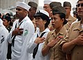 US Navy 090528-N-3207B-064 Sailors, Marines, Soldiers and Airmen recite the pledge of allegiance during a naturalization ceremony at the USS Midway Museum.jpg