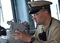 US Navy 090603-N-3165S-002 Senior Chief Quartermaster David Tokarski looks through a sexton on the bridge of the multi-purpose amphibious assault ship USS Bataan (LHD 5) during the ship's Battle of Midway remembrance.jpg