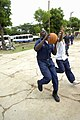 US Navy 090713-F-7923S-154 Serviceman 3rd Class Quechez Hawkins, embarked aboard the Military Sealift Command hospital ship USNS Comfort (T-AH 20), plays basketball with a Nicaraguan student.jpg