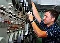 US Navy 090928-N-8132M-023 lectronics Technician 3rd Class Matthew Hanneman, from New London, Wis., monitors the voltage.jpg