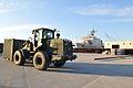 US Navy 100115-N-1831S-035 Marines load supplies aboard USS Bataan (LHD 5).jpg