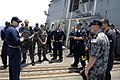 US Navy 100506-N-8959T-103 Lt. Timothy Shanley, operations officer aboard the Arleigh Burke-class guided-missile destroyer USS Farragut (DDG 99), welcomes aboard a group of Australian navy Sailors.jpg