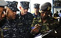 US Navy 100510-N-9643W-024 Jamaica Defense Force Coast Guard National Reserve Sub Lt. Althia White, completes paperwork to participate in subject matter exchanges before boarding High Speed Vessel Swift (HSV 2).jpg