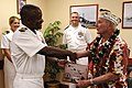 US Navy 101208-N-7498L-525 Capt. Richard L. Clemmons Jr. presents a gift to Woody Derby, a Pearl Harbor survivor who served aboard the battleship U.jpg