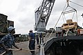 US Navy 111009-N-MW330-022 Sailors aboard the forward-deployed amphibious dock landing ship USS Germantown (LSD 42) raise a vehicle from the well d.jpg