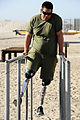 US Navy 111202-N-JR159-026 A wounded service member from Naval Medical Center San Diego participates in the obstacle course at the Naval Special Wa.jpg