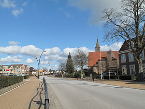 Voorthuizen - Voorthuizen, street with church in the background