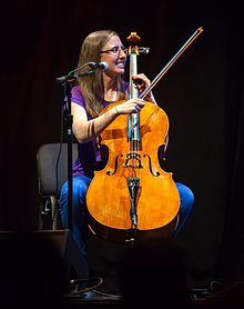 Photograph of Aubrey playing a cello.