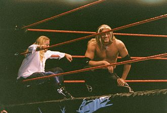 Christian Cage - Christian (left) with Edge in their Brood attire, which they used along with gothic symbols