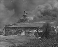 Warehouse engulfed in a raging blaze. St. Louis - NARA - 283525.tif