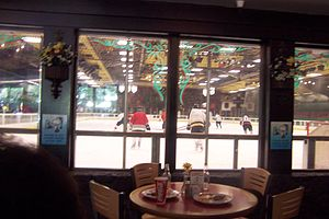 Snoopy's Home Ice - Hockey players on the ice, as seen from the Warm Puppy Cafe.