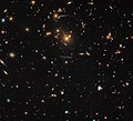 Warped and distorted SDSS J1050+0017.jpg