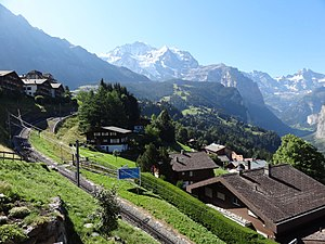 Wengen - The Wengeralpbahn leading into the town. The Jungfrau is visible in the background.