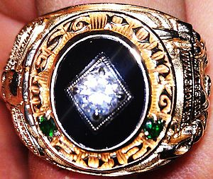 """United States Military Academy class ring - A class of 2012 ring, """"For More Than Ourselves""""."""