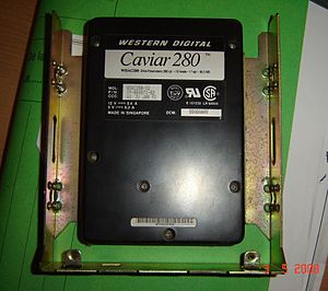 Western Digital - Western Digital Caviar 80 MB (model number WDAC280-32), from a series of HDDs for desktop PCs; it is a 3.5-inch HDD mounted onto a 5.25-inch adapter bracket.
