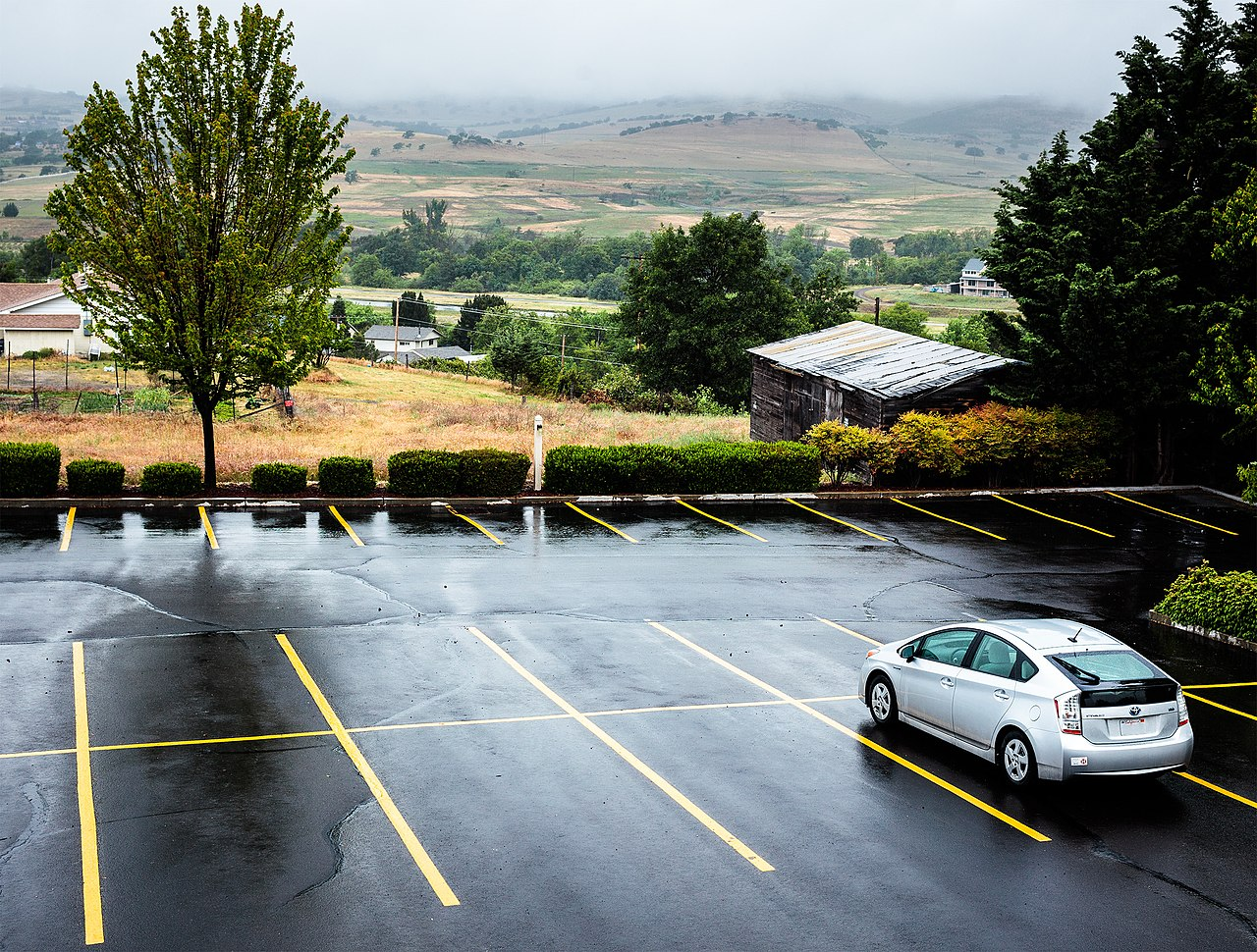 File:Wet Prius, alone in an empty parking lot (9927867963 ...