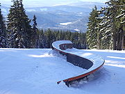 S-rail at the bottom of the same terrain park at Timberline Lodge ski area
