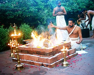 Yajurveda - Yajurveda text describes formula and mantras to be uttered during sacrificial fire (yajna) rituals, shown. Offerings are typically ghee (clarified butter), grains, aromatic seeds, and cow milk.