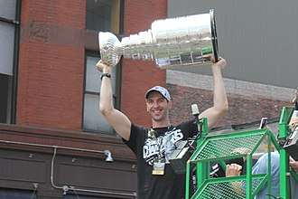 Zdeno Chára - Chára hoisting the Stanley Cup during the Bruins' 2011 victory parade
