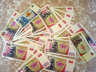 History of Zimbabwe - GBP 8 worth of Zimbabwean dollars in 2003
