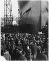 """USS CALIFORNIA (BB44) Launching Ceremony, showing a closeup of the bow view looking down the ways to the stern, on... - NARA - 296909.tif"