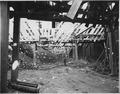 """Under the trusses in 'block 40'. - NARA - 294048.tif"
