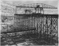 """Upstream concrete placing trestle with Hammerhead crane, whirley and erecting stiffleg derrick. Average height of... - NARA - 294230.tif"
