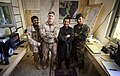(From left) Afghan Local Police patrolman Hazrat Ali; U.S. Marine Cpl. Nathan Dittmer; Afghan National Directorate of Security 1st Lt. Maiwand Salim; and Afghan National Army Sgt. Anamullah work together 120307-M-MM918-004.jpg