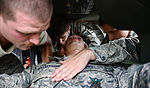1-228th Aviation Regiment, 612th Air Base Squadron work together during crash rescue training 150115-F-ZT243-051.jpg
