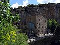 132 Sant Miquel del Fai, la casa del priorat des de l'escala que baixa a la cova.JPG