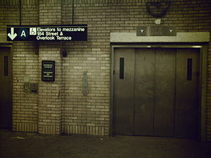 181st Street (IND Eighth Avenue Line) - The upper mezzanine's elevator bank