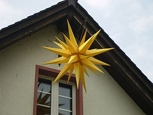 Moravian star - A completed Moravian star hanging by a church