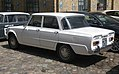 1968 Alfa Romeo Giulia 1300TI berlina in white, rear left.jpg